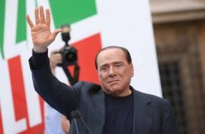 Berlusconi greets supporters