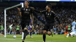 Juventus' Mario Mandzukic celebrates with Alvaro Morata  after scoring a goal during the Champions League group D soccer match between Manchester City and Juventus at the Etihad Stadium, Manchester, England, Tuesday, Sept. 15, 2015. (AP Photo/Jon Super)