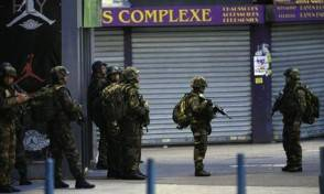Soldiers operate in St. Denis, a northern suburb of Paris, Wednesday, Nov. 18, 2015. Authorities in the Paris suburb of St. Denis are telling residents to stay inside during a large police operation near France's national stadium that two officials say is linked to last week's deadly attacks. (ANSA/AP Photo/Christophe Ena)