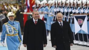 Russia's President Vladimir Putin (R) and Turkey's President Tayyip Erdogan review a guard of honour during a welcoming ceremony at the Presidential Palace in Ankara, December 1, 2014. Putin arrived for talks expected to focus on trade and energy issues. REUTERS/Umit Bektas (TURKEY)