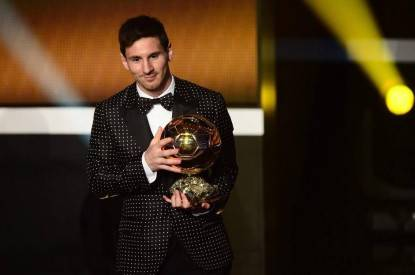 Barcelona's Argentinian forward Lionel Messi receives the FIFA Ballon d'Or award during the FIFA Ballon d'Or awards ceremony at the Kongresshaus in Zurich on January 7, 2013.  AFP PHOTO / OLIVIER MORIN