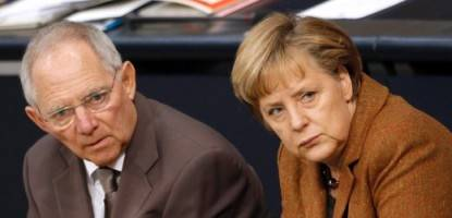 German Finance Minister Schaeuble and Chancellor Merkel attend a session of the lower house of parliament Bundestag in Berlin