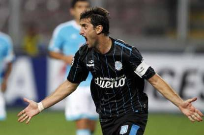 Argentine's Racing's Milito celebrates goal against Peru's Sporting Cristal during their Copa Libertadores match in Lima