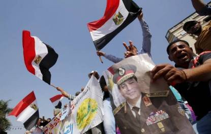 Supporters of Egypt's army and Egyptian President Abdel Fattah al-Sisi dance and cheer as they celebrate the anniversary of Sinai Liberation Day in Cairo