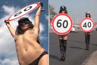 Topless-women-persuade-drivers-to-slow-down (1)