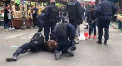 Coronavirus polizia francese sbatte a terra una donna